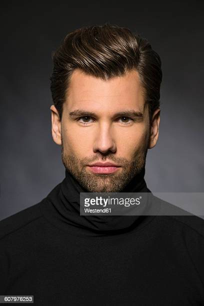 Portrait of man wearing black turtleneck