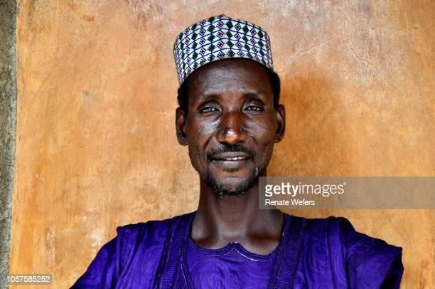 portrait of man wearing cap - áfrica del oeste fotografías e imágenes de stock