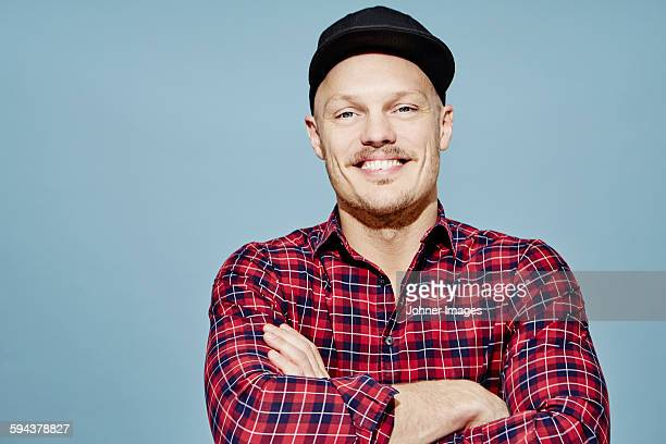 Portrait of man wearing checked shirt