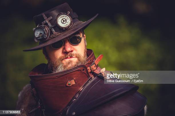 portrait of man wearing costume - steve guessoum stockfoto's en -beelden