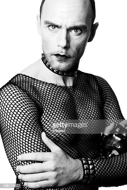 portrait of man wearing fishnet shirt and lipstick - fetish wear stock photos and pictures
