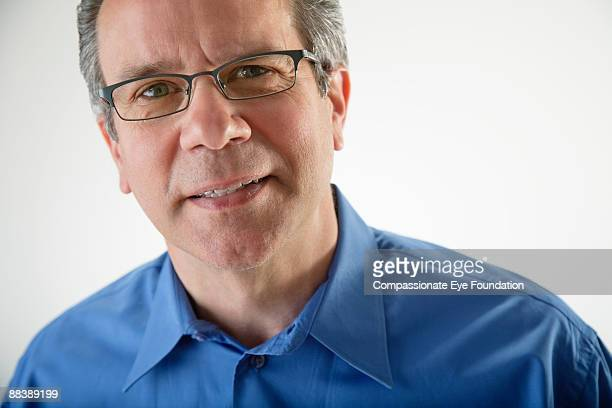 "portrait of man wearing glasses - ""compassionate eye"" stock-fotos und bilder"