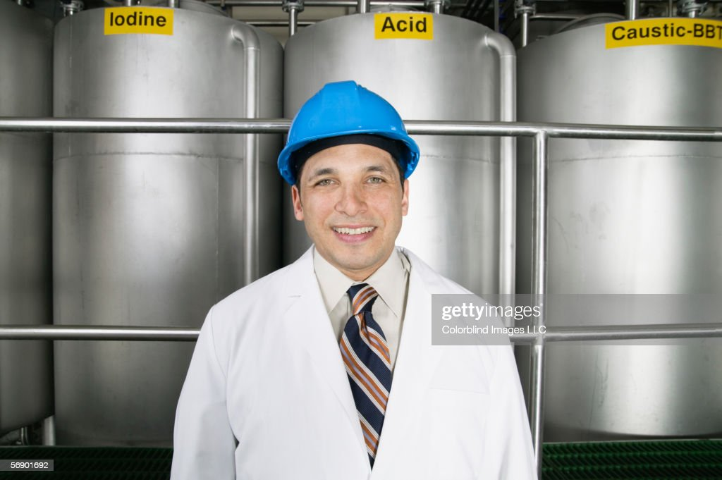 Portrait of man wearing hardhat and lab coat : Stock Photo