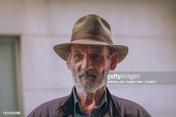portrait of man wearing hat - police mugshot stock pictures, royalty-free photos & images