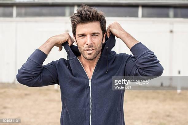 Portrait of man wearing hooded jacket