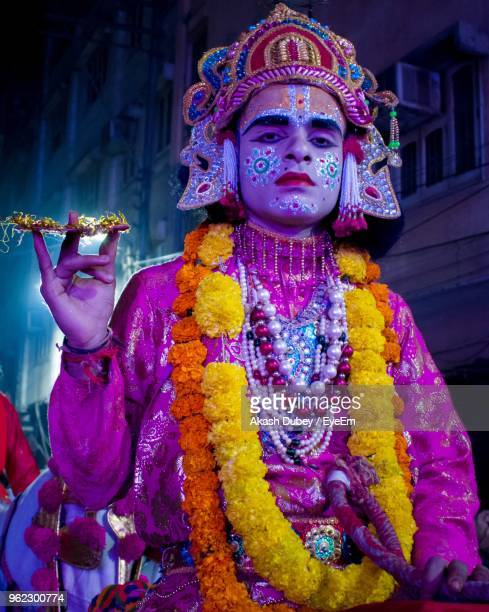 portrait of man wearing krishna costume at night - lord krishna stock pictures, royalty-free photos & images