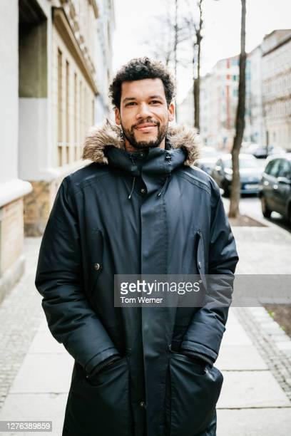 portrait of man wearing parka - black colour stock pictures, royalty-free photos & images