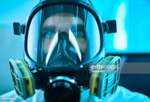 portrait of man wearing respirator - gas mask stock pictures, royalty-free photos & images