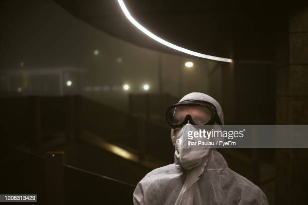 portrait of man wearing sunglasses standing against illuminated ceiling - nuclear reactor stock pictures, royalty-free photos & images