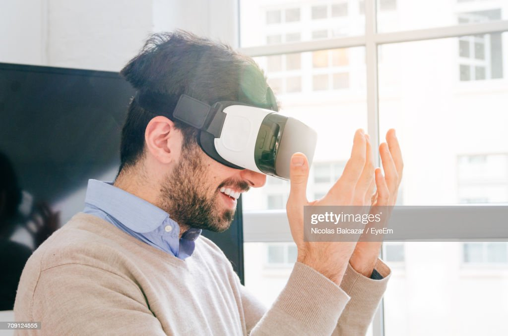 Portrait Of Man Wearing Virtual Reality Simulator : Stock Photo