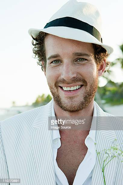 Portrait of man wearing white trilby