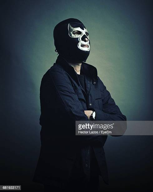 portrait of man wearing wrestling mask - wrestling stock pictures, royalty-free photos & images