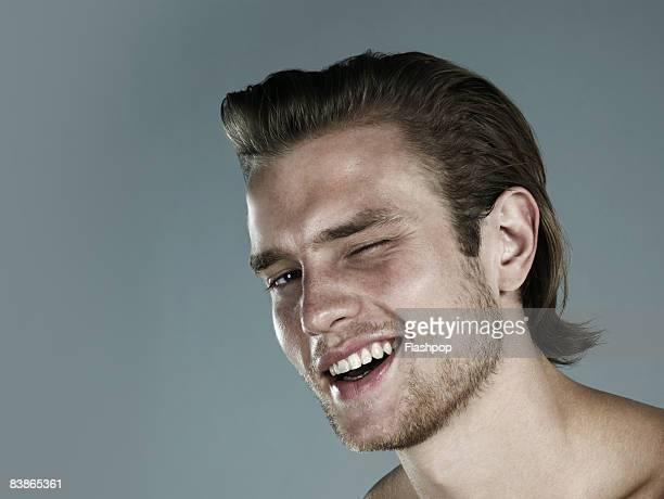 Portrait of man winking
