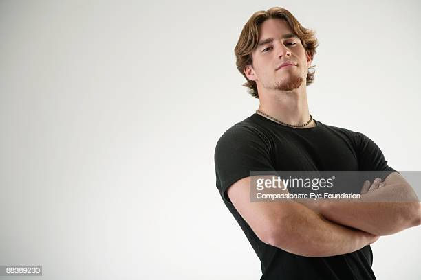 "portrait of man with arms crossed - ""compassionate eye"" stock pictures, royalty-free photos & images"