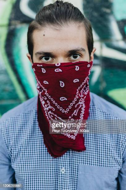 portrait of man with bandana covering face - bandana stock pictures, royalty-free photos & images