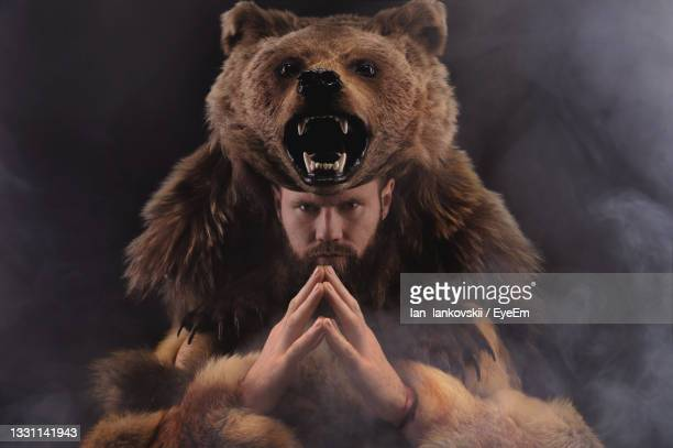 portrait of man with bear costume - bear suit stock pictures, royalty-free photos & images