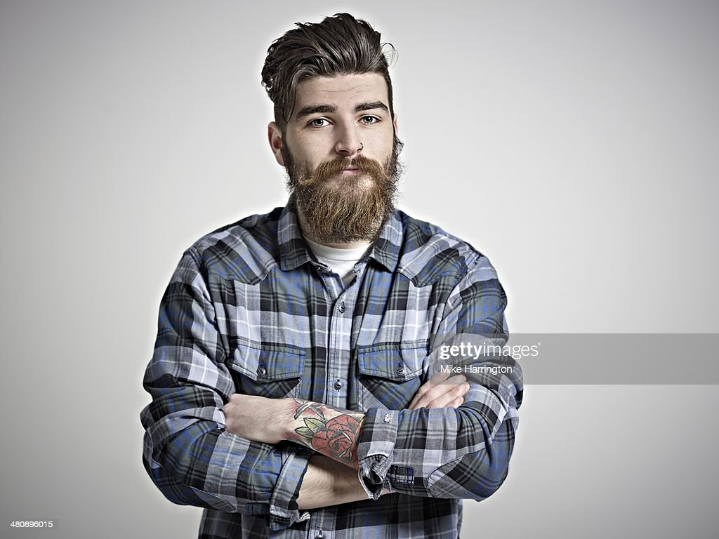 Portrait of man with beard, tattoos & check shirt. : Stock Photo