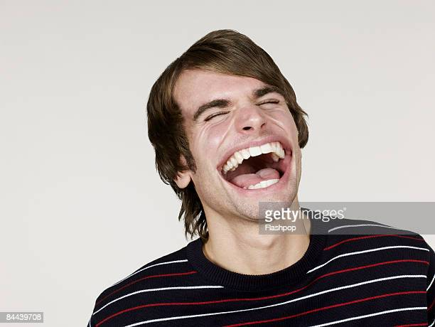 Portrait of man with big mouth laughing