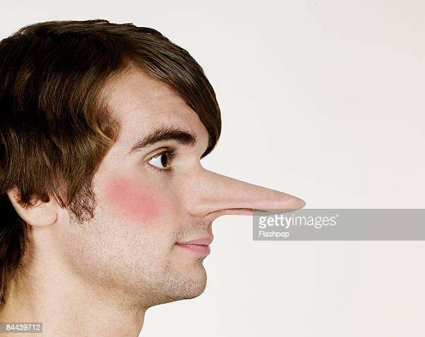 portrait of man with big nose - big nose stock photos and pictures
