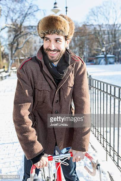 portrait of man with bike in winter - fur hat stock pictures, royalty-free photos & images