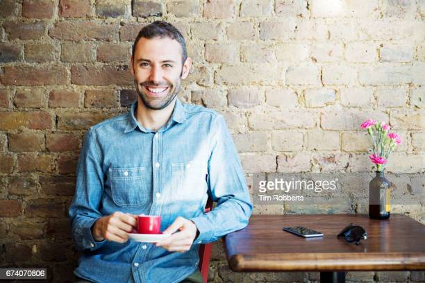 Portrait of man with coffee
