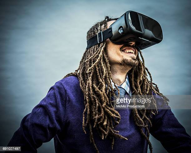 Portrait of man with dreadlocks and VR goggles