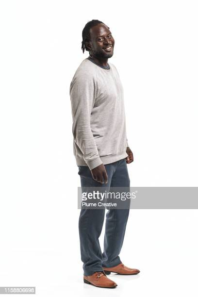 portrait of man with dreadlocks in studio - white background stock pictures, royalty-free photos & images