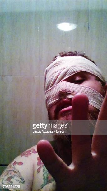Portrait Of Man With Face Covered Bandage