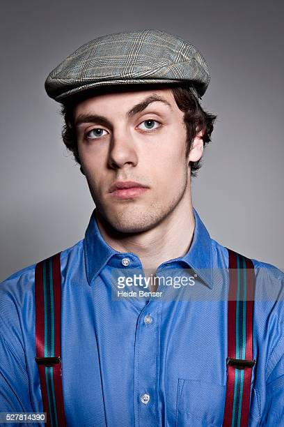 portrait of man with flat cap and suspenders - flat cap stock pictures, royalty-free photos & images