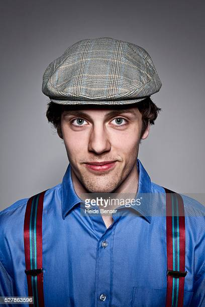 Portrait of man with flat cap and suspenders