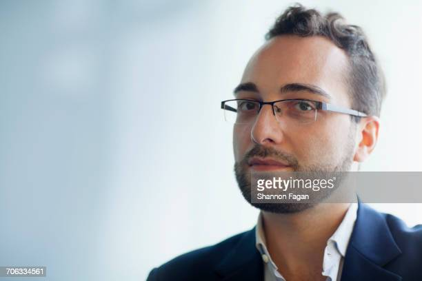 Portrait of man with glasses in office