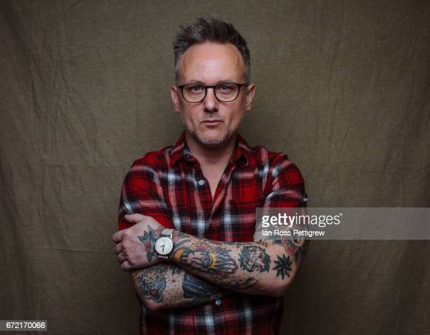 Portrait of man with glasses, tattoos