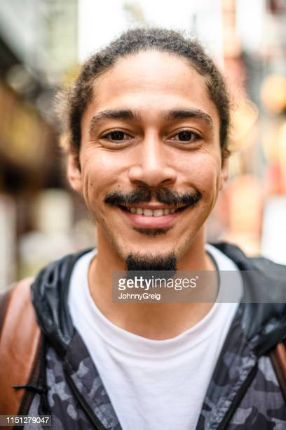 portrait of man with goatee and moustache smiling - goatee stock pictures, royalty-free photos & images