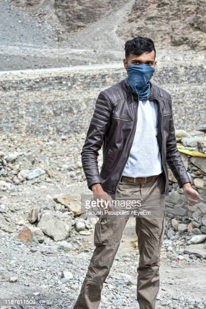 portrait of man with handkerchief covering face standing on land - handkerchief - fotografias e filmes do acervo