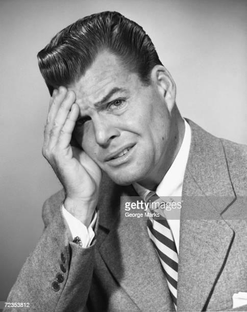 Portrait of man with headache