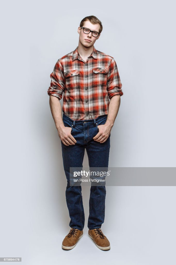 Portrait of man with jeans & red check shirt : Stock-Foto