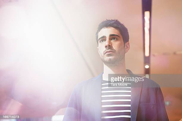 portrait of man with lighting flare