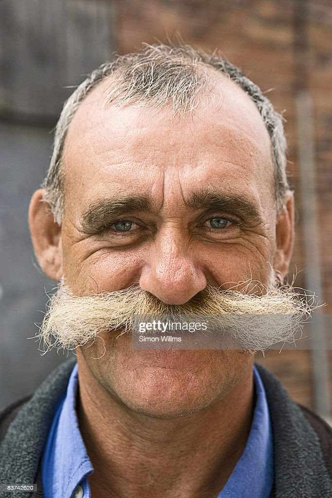 Portrait of man with mustache : Stock Photo