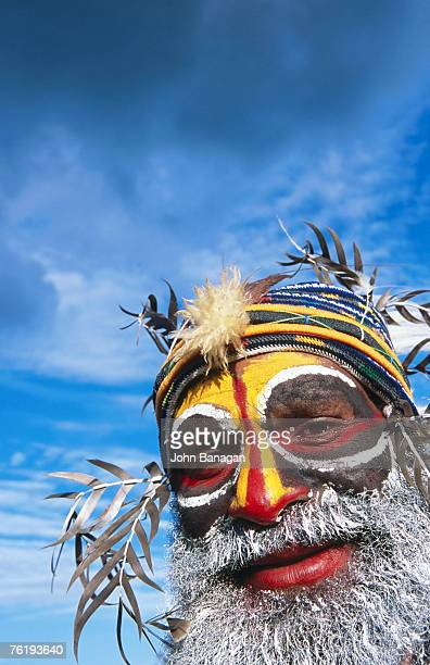 Portrait of man with painted face at Enga Cultural Show, Wabag, Enga, Papua New Guinea, Pacific