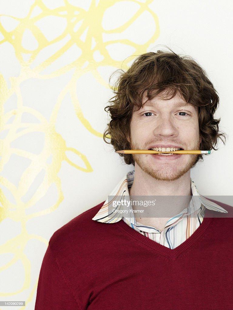 Portrait of man with pencil : ストックフォト