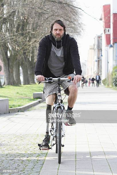 Portrait of man with prosthesis leg cycling