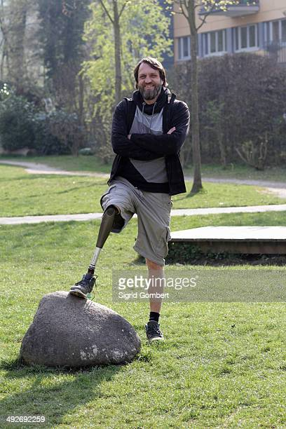 portrait of man with prosthesis leg in park - sigrid gombert stock pictures, royalty-free photos & images
