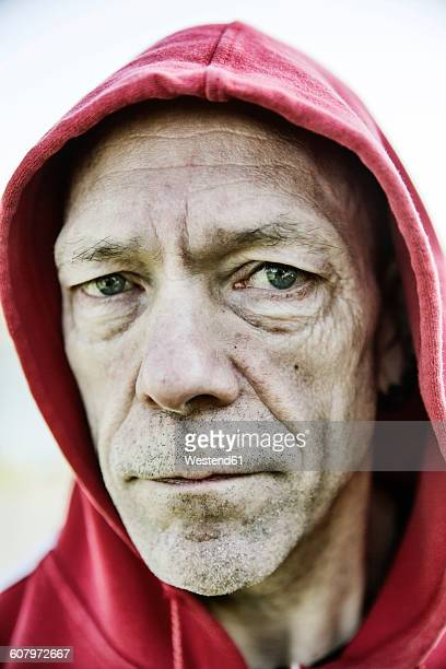 Portrait of man with red hood