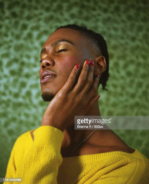 portrait of man with red nail polish, toronto, canada - images stock pictures, royalty-free photos & images