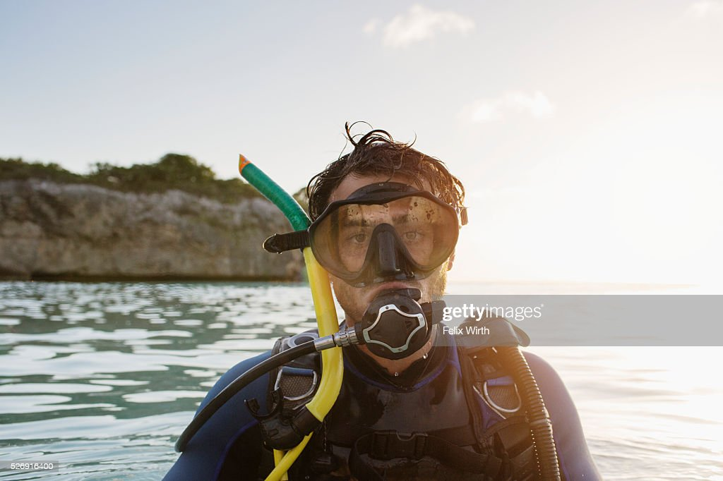 Portrait of man with scuba diving equipment in sea : Stock Photo