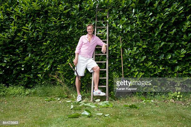 Portrait of man with secateurs by ladder