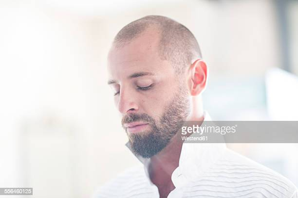 Portrait of man with shaved head and beard