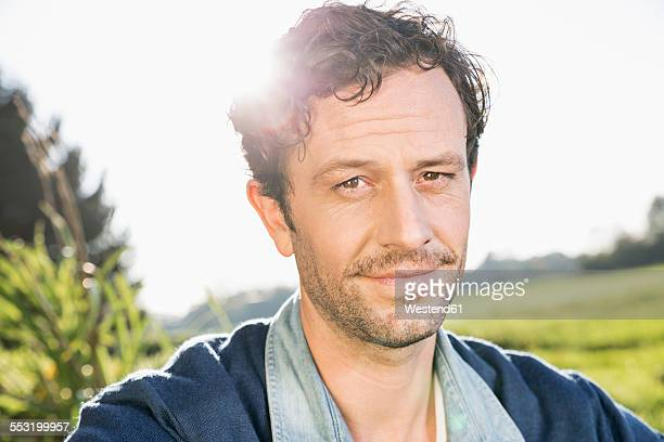 Portrait of man with stubble at backlight