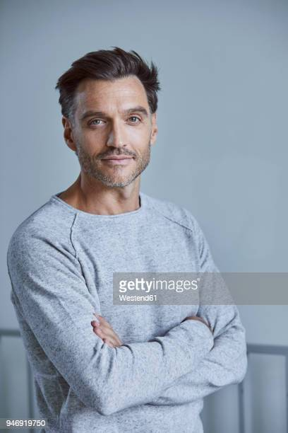 portrait of man with stubble wearing grey sweatshirt - waist up stock pictures, royalty-free photos & images