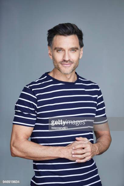Portrait of man with stubble wearing striped t-shirt